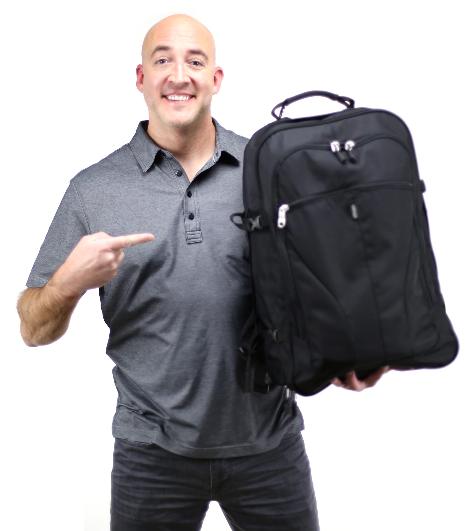 Author holding a small black travel backpack.